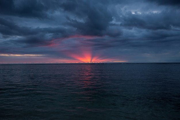 Aerial panoramic view of sunset over ocean.