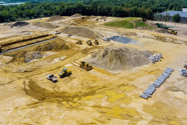 Aerial panoramic view at work preparing ground construction in new residential building