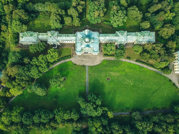 Aerial photo of an abandoned palace in the woods. green lawn, trees, summer day. russia, st. petersburg, peterhof. flat lay.