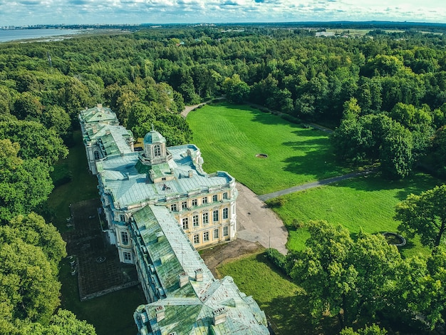 Aerial photo of an abandoned palace in the woods. green lawn, trees, summer day. russia, st. petersburg, peterhof