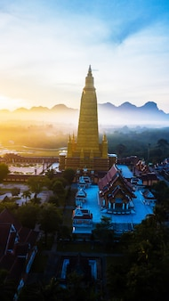 Aerial photo  of beautiful temples in the morning atmosphere , thailand .