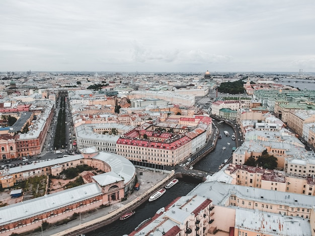 Aerial photo center of st. petersburg, roofs, moika river, neva river, palace square. sunset light.