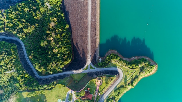 Aerial photo from flying drone of asphalt road around the dam,beautiful nature landscape