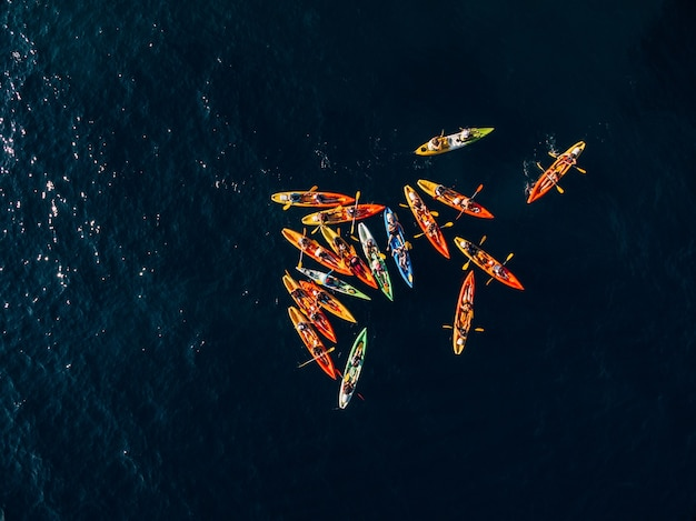 Aerial photo of a group of kayakers paddling in the sea