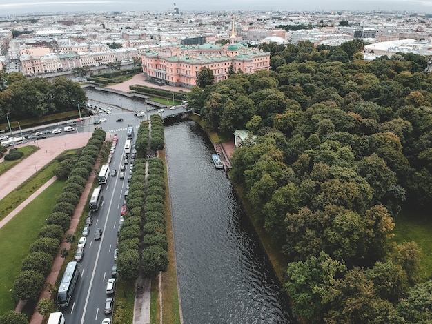 Aerial photo of the moika river, the center of st. petersburg, mikhailovsky park, mikhailovsky palace, engineering palace, roofs, river boats
