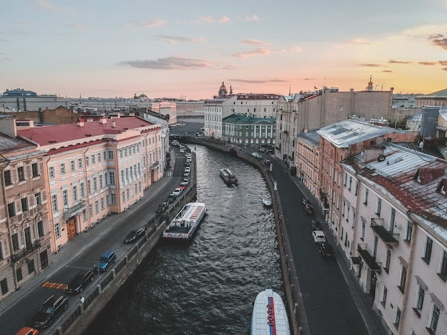 Aerial photo of the moika river in the sunset light. river boats, top view. russia, st. petersburg