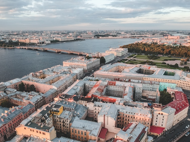 Aerial photo of the neva river in the sunset light. river boats russia, st. petersburg