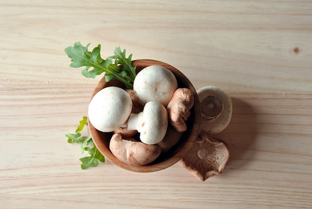 Aerial photo of shitake with mushrooms on wooden table