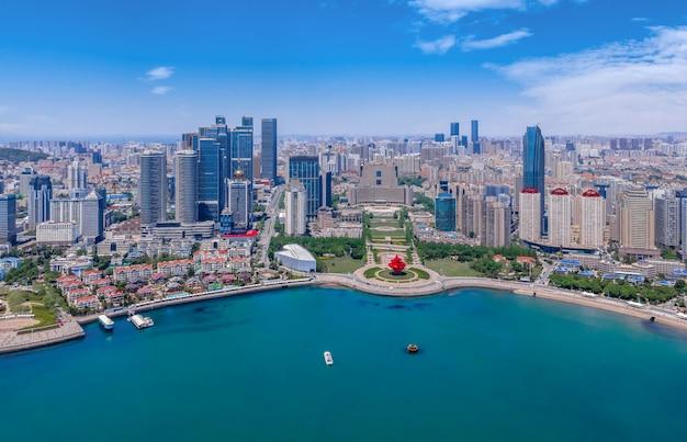 Aerial photography of architectural landscape skyline along qingdao urban coastline