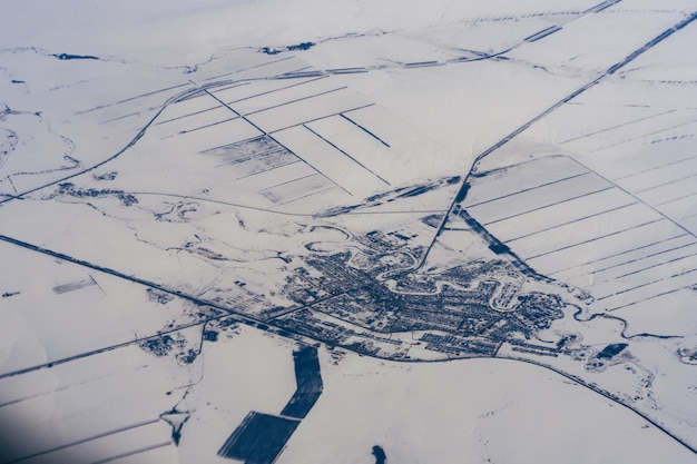 Aerial photography of city in the snow in winter in siberia in russia