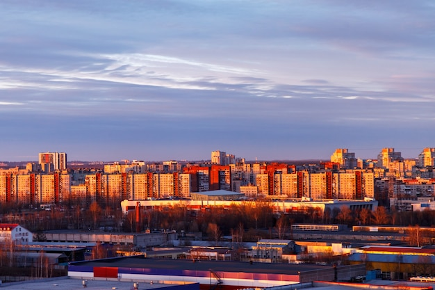Aerial photography of the evening industrial district of a large russian city with warehouses, warehouses, offices and buildings. beautiful sky at sunset.