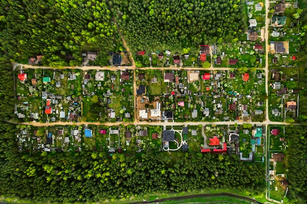 Aerial photography from above of a residential dacha village in the forest suburban real estate in belarus