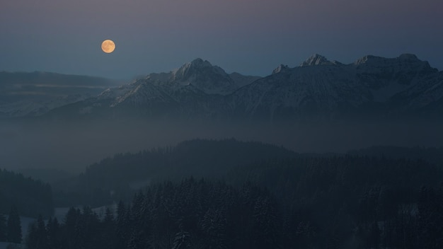 Aerial photography of mountain viewing full moon