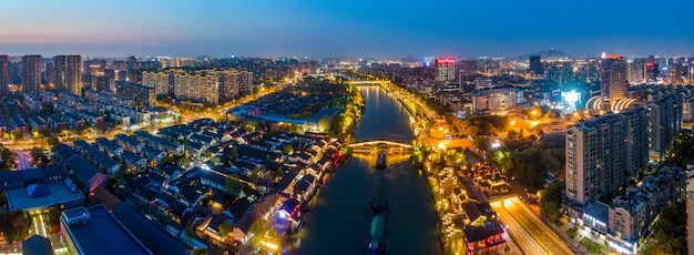 Aerial photography of the night view of the ancient buildings on the gongchen bridge in hangzhou