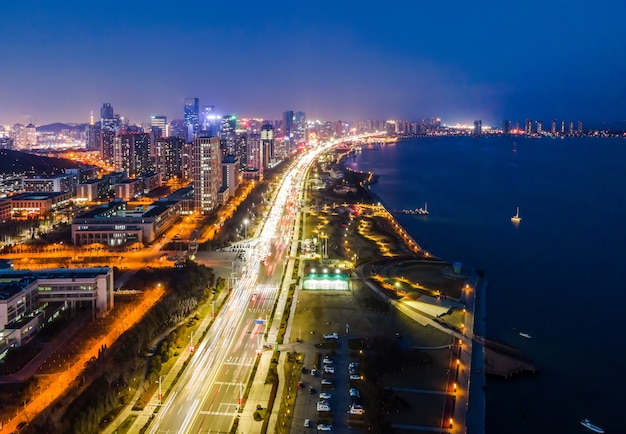 Aerial photography of the night view of the urban architectural landscape of qingdao, china