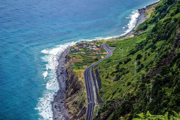 Aerial photography shot of a highway in the mountains on the shore of madeira
