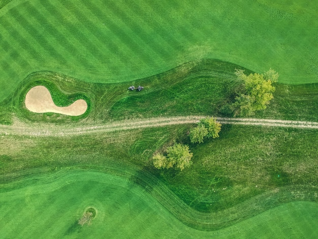 Aerial photos of golf club, green lawns, forests, lawn mowers, flat lay