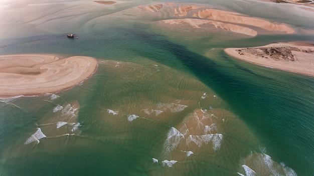 Aerial. sandy beaches in ria formosa, fuseta and seagulls.