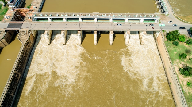 Aerial shooting spring flood water flowing hydroelectric power station dam