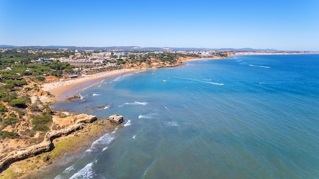 Aerial. shores of the village olhos de agua are shot from sky by drones.