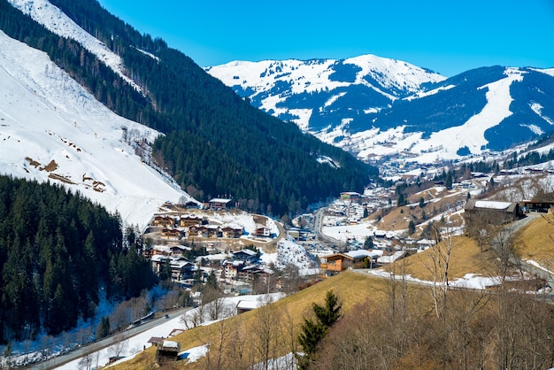 Aerial shot of austrian alps village during a winter day