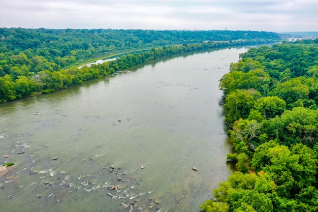 Aerial shot of a beautiful james river in virginia, usa with a cloudy sky