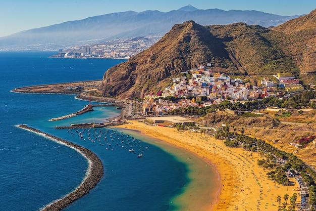 Aerial shot of the beautiful las teresitas beach located in san andrés, spain