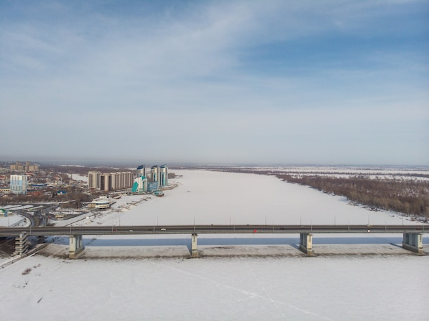 Aerial shot of bridge and car driving on the bridge