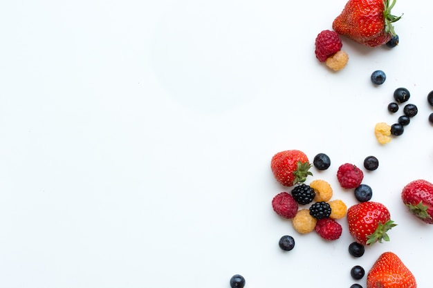 Aerial shot of colorful healthy fresh berries on a white background