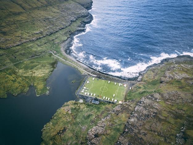 Aerial shot of eidi soccer stadium at faroe islands