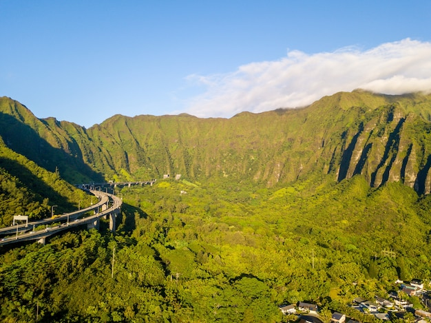 Aerial shot of famous stairs through the oahu green mountains in kaneohe, hawaii