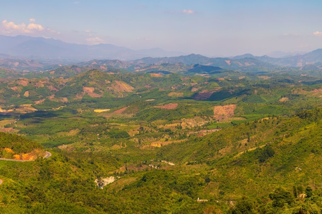 Aerial shot of forested mountains in dalat