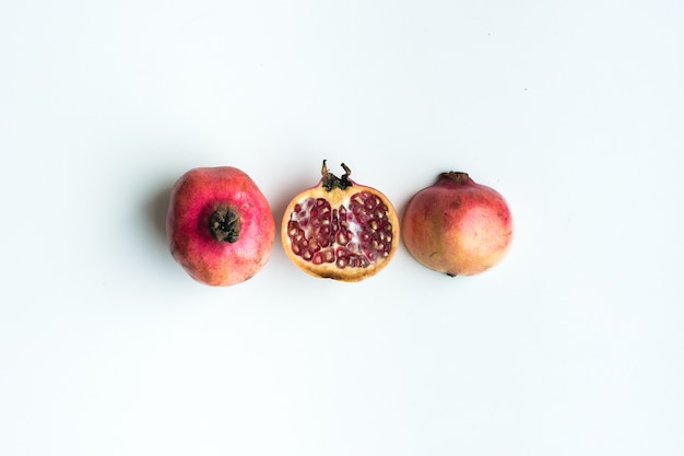 Aerial shot of fresh cut pomegranate on a white background