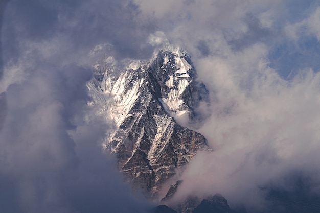 Aerial shot of the himalayas mountain above the clouds