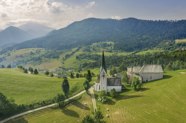 Aerial shot of the lese church in slovenia in a valley