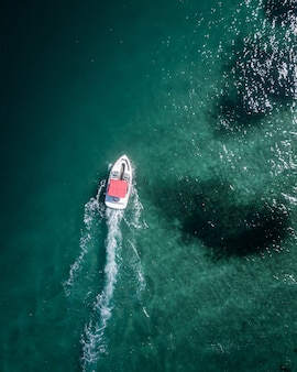 Aerial shot of a motorboat moving forward in the sea