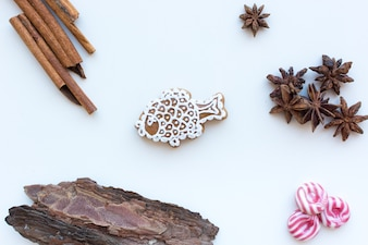 Aerial shot of a cute Christmas cinnamon gingerbread with icing on a white background