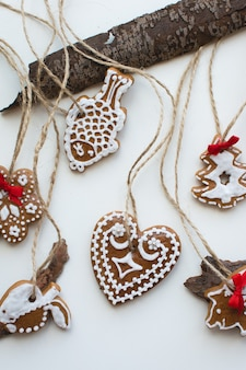 Aerial shot of bunch of Christmas cinnamon gingerbreads on a white background