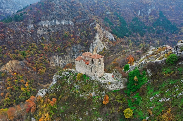 Aerial shot of an old building on top of a cliff