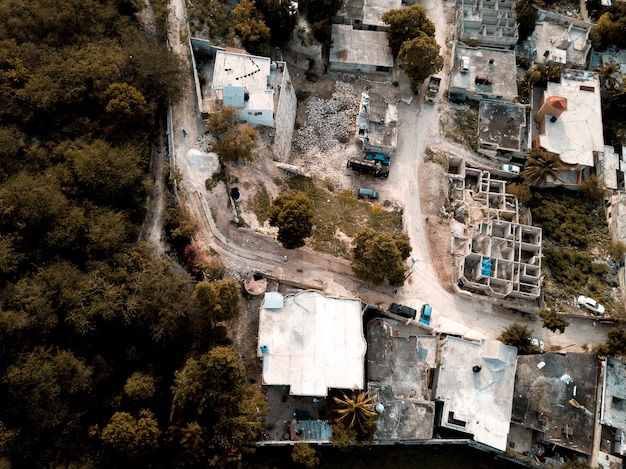 Aerial shot of roads in the middle of old buildings near trees