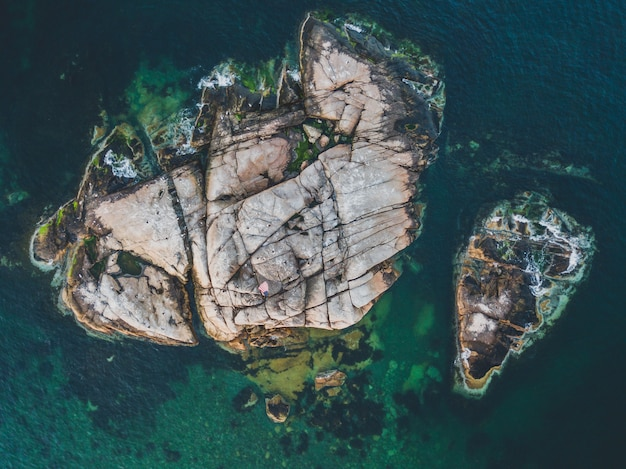 Aerial shot of a rocky island in an ocean