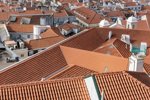Aerial shot of rooftops of city buildings with red shingles