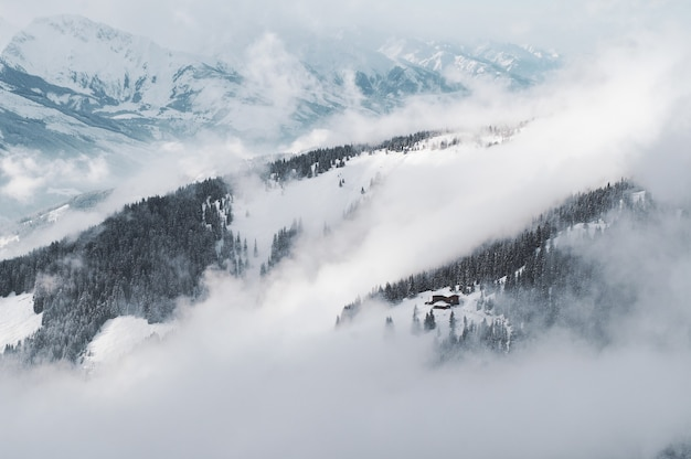 Aerial shot of a snowy mountain of zell am see-kaprun in austria