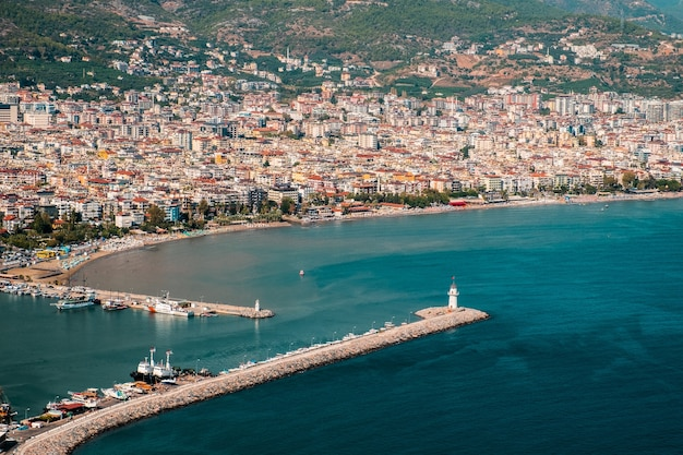 Aerial shot of the stunning alanya resort town's residential areas and the sea on a sunny day