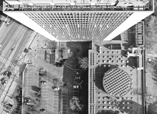 Aerial shot of a tall business building in black and white