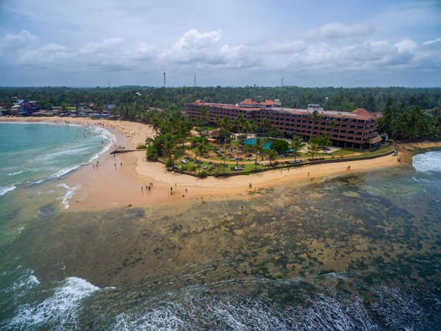 Aerial shot of a tropical beach in sri lanka perfect for a family vacation