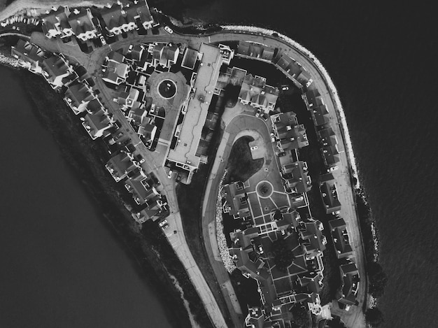 Aerial shot of an urban island in black and white