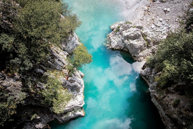 Aerial shot of the valbona valley national park with reflecting waters in albania