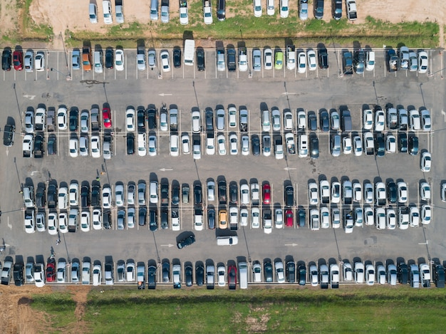 Aerial shot over vehicles at shopping mall parking lot Premium Photo