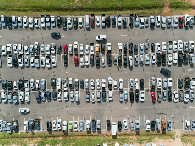 Aerial shot over vehicles at shopping mall parking lot